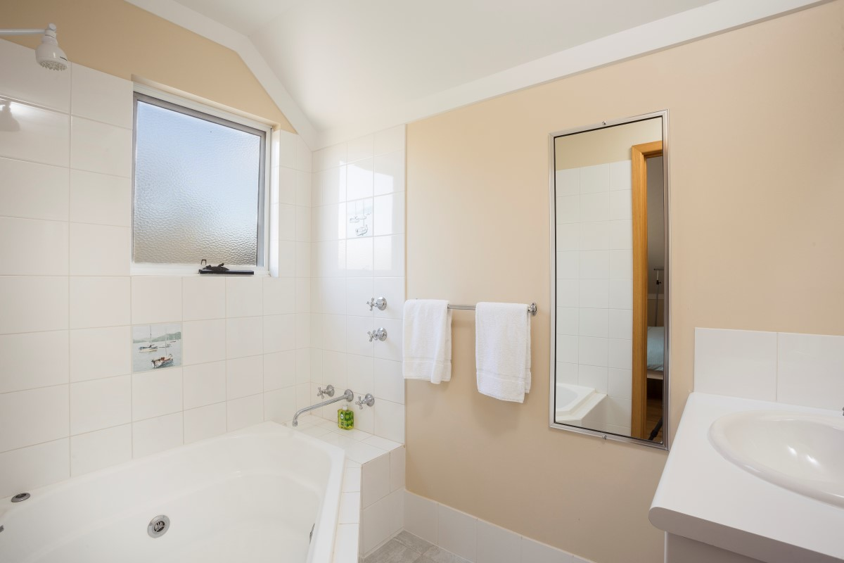 Showers, toilets & hand basins. Upstairs ensuite with shower over spa bath. Towels & soaps provided.